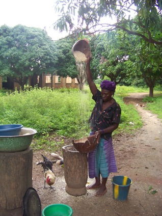 My host mother in Kayero, preparing some millet or corn, I don't remember which, to be eaten that same night.