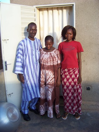 My friend, Tasré Bouda, with his wife and her friend, on a Friday.